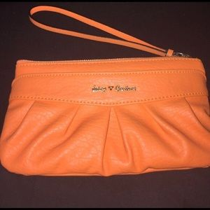 Cute orange juicy couture wristlet